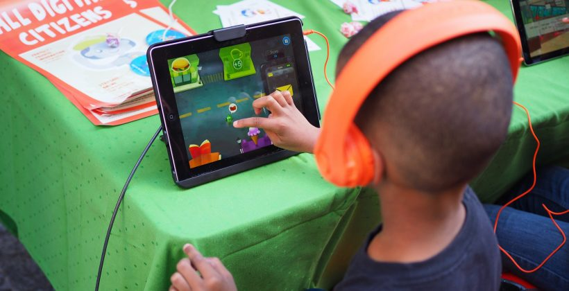 little boy playing educational game on ipad