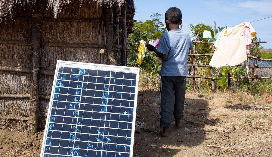 solar panel and little boy