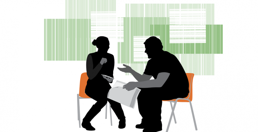 consultation with man and woman facing each other in chairs