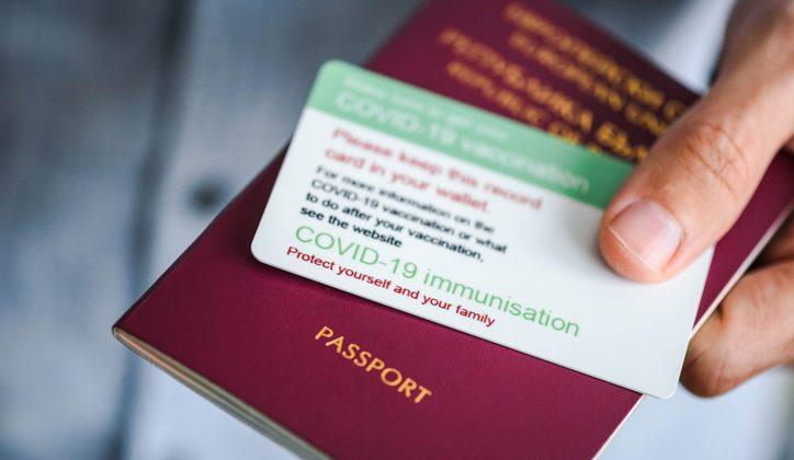 covid-19 vaccine passport and regular passport