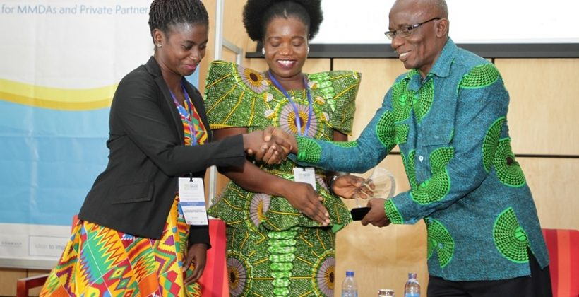 man congratulating woman at prize award