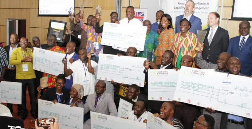 group photo with people holding their prize winning cheques